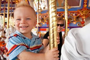 Child Having Fun on the Carousel